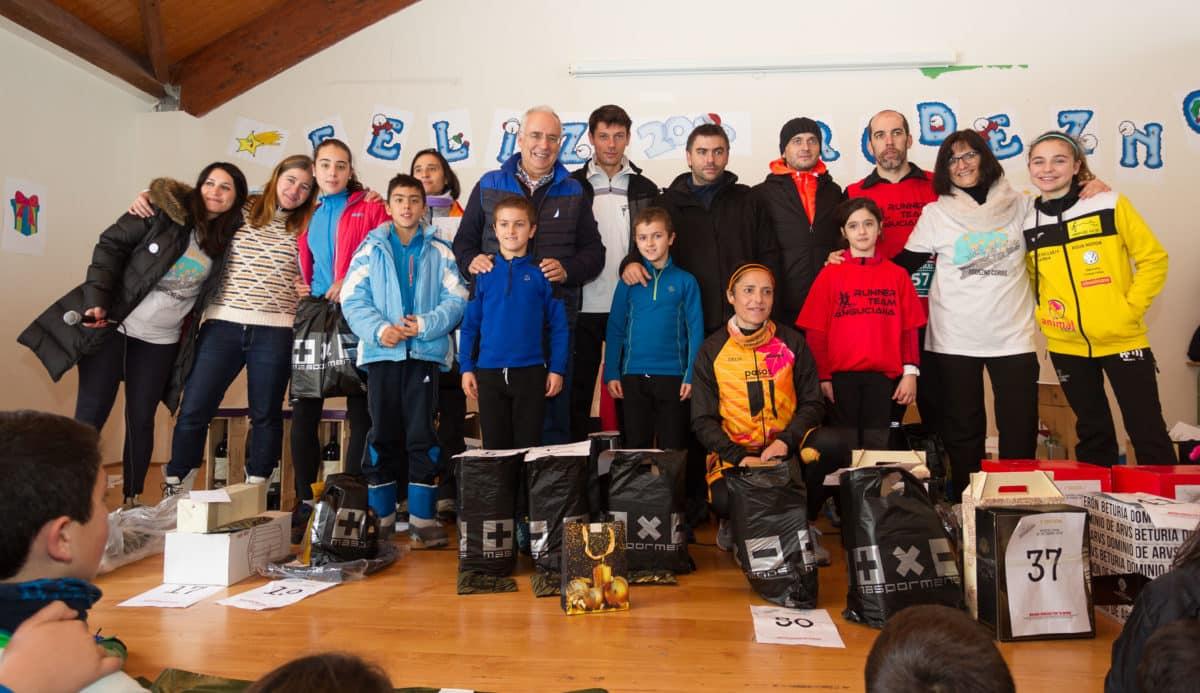 Unos 400 corredores desafían a la nieve y el frío para correr contra el cáncer infantil en Rodezno 12